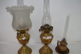 THREE VINTAGE BRASS BASED OIL LAMPS