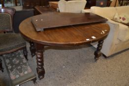 EARLY TO MID 20TH CENTURY OAK EXTENDING DINING TABLE WITH ADDITIONAL LEAF, RAISED ON HEAVY BARLEY