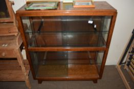 EARLY 20TH CENTURY OAK DISPLAY CABINET WITH SLIDING GLASS DOORS