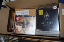 BOX OF PLAYSTATION GAMES AND DVDS