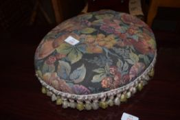 SMALL OVAL FLORAL UPHOLSTERED FOOT STOOL