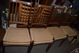 SET OF FOUR RETRO TEAK DINING CHAIRS WITH RATTAN SEATS