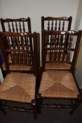 SET OF FOUR 20TH CENTURY OAK RUSH SEAT AND SPINDLE BACK DINING CHAIRS