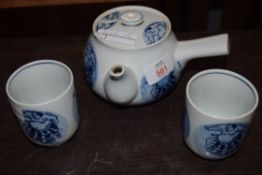 SMALL CONTEMPORARY ORIENTAL TEA POT AND TWO CUPS