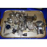 TRAY OF MIXED SILVER PLATED CUTLERY, TOAST RACK, CONDIMENT ITEMS, CREAM JUG, SUGAR BASIN ETC