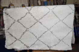 Zipcode design cream area rug, 120 x 170cm. RRP £62.99