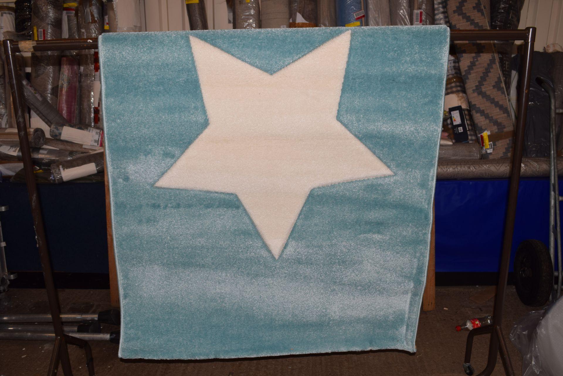 Isabel & Max Benjamin blue rug, 120 x 170cm RRP £65.99