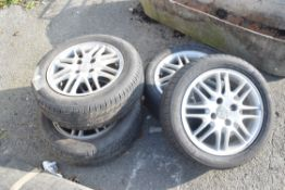 FOUR ALLOY WHEELS FOR A FORD MOTOR CAR