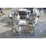 TWO COMPOSITE GARDEN PLANTERS IN THE SHAPE OF CHIMNEYS