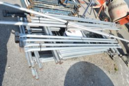 GALVANISED SCAFFOLDING TOWER WITH ANGLED SUPPORTS, ADJUSTABLE FEET AND BOLTS ETC FOR OUTRIGGERS