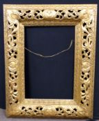An elaborately carved floral gilt frame. Approx 44x34 inches.