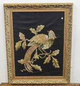 A decorative embroidery of a bird with foliage on black background . NA. Approx 17x13 inches.