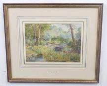 SAMUEL JOHN LAMORNA BIRCH (British, 19th century), A view of a stone bridge with woodland glade,