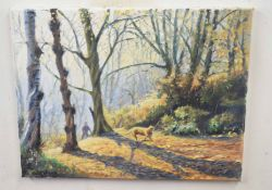 Kenneth Grant (British 20C), Opening woodland with a dog carrying a branch. Oil on canvas, signed.