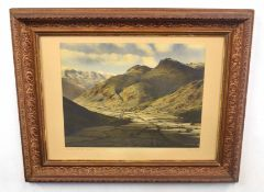 British, 20th century, An expansive landscape 'Sunlight in the Valley, Langdale Pikes', inscribed