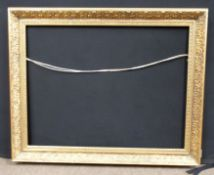 Gilt frame with running pattern. Approx 36-26 inches.