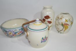 Group of Poole pottery including a bowl with floral design, two vases and a biscuit barrel