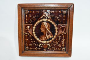 Treacle glaze tile, the centre with image of Queen Victoria, the tile in wooden frame, 18cm width