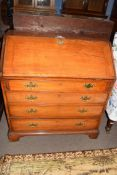 George III faded mahogany bureau with fall front opening to a shelved interior over four long