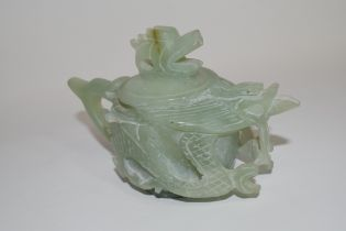 Green soapstone Chinese tea pot, modelled in relief with dragons and dragon finial, 9cm high
