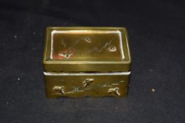 Small Chinese brass box of hinged rectangular form decorated with flying birds, 5.5cm long