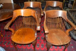 Set of four late 19th century North country oak bow and spindle back chairs with saddle seats,