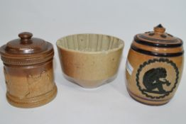 Quantity of salt glaze items including a Doulton Lambeth tobacco jar decorated with a monkey in