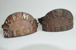 Pair of Victorian cast brass fireman's arm plaques dated 1881, semi-circular plaques mounted on