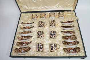 Cased Crown Derby coffee set comprising 10 coffee cans and 12 saucers