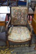 19th century mahogany framed armchair with tapering legs raised on casters, 92cm high