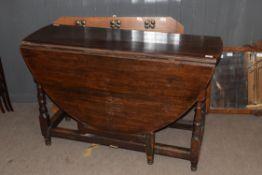18th century oval oak gateleg table raised on turned legs, 120cm wide