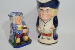 Two English pottery Staffordshire type Toby jugs including one of the foaming quart (2)
