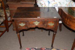 George III oak three drawer lowboy, raised on tapering legs with pad feet, 75cm wide