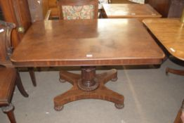 19th century mahogany pedestal dining table, the rectangular top over a turned column with four