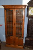 Late 19th century light oak bookcase cabinet, with two large lead glazed doors with Art Nouveau
