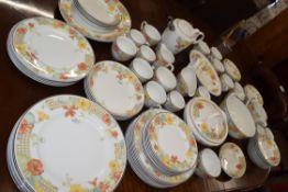 An extensive Wedgwood dinner service in the trellis flower pattern including 8 dinner plates, side