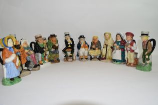 Collection of Dickens character Toby jugs modelled by Peter Jackson for the firm of Wood & Sons,