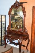 20th century hardwood demi-lune hall table with mirror back, extensively carved with foliate detail,