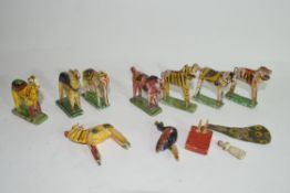 Collection of Indian painted wooden animal figures to include tigers, horses, peacocks, elephants