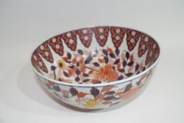 Chinese porcelain bowl with an iron red design of flowers, 25cm diam