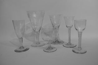 Collection of glass wares including a large air twist ale glass with engraving fruiting vine