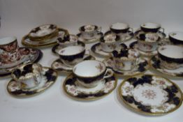 Part Coalport tea service with a floral design on gilt and blue ground comprising 12 cups,