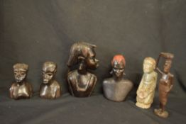 Group of six various hardwood African tribal carved figures together with a further carved stone