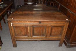 18th century oak coffer of typical form, three panelled front with hinged lid opening to a void