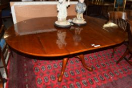 Good quality reproduction cherry wood dining table, the oval planked top set on a heavy turned