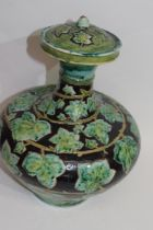 Della Robbia pottery vase, the brown ground with a green leaf decoration, factory mark to base