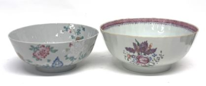 Two 18th century Chinese export porcelain bowls with floral designs, the largest 26cm diam (2)