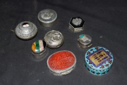 Collection of sterling silver and white metal pill boxes to include a Jordanian enamelled example,