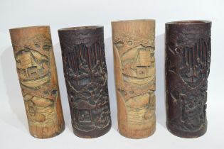 Group of four Chinese bamboo brush pots with various typical carvings of Chinese characters and