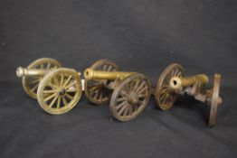 Group of three 20th century cast metal models of cannons, approx 10cm high (3)